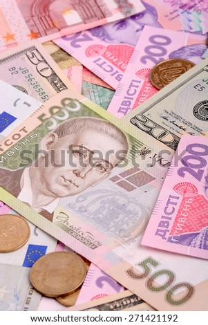 european money euro, american money dollars, ukrainian money hryvnia, financial background - stock photo