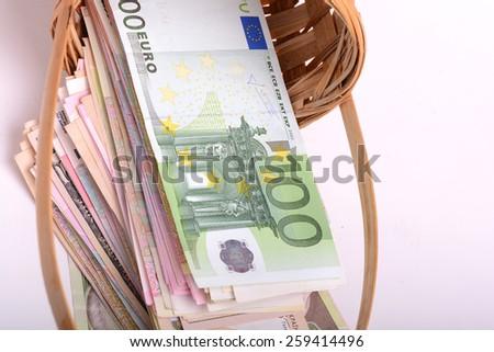 european money set in a basket - stock photo