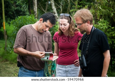 European or American tourist with expert nature guide in Costa Rica