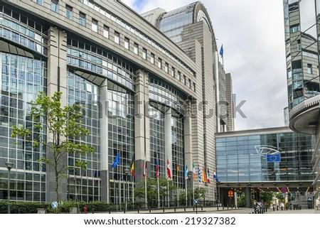 European Parliament Building and European flags. Brussels, Belgium. - stock photo