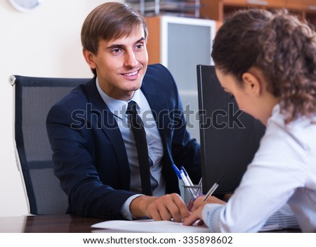 european professional teaching new employee in practice at company - stock photo
