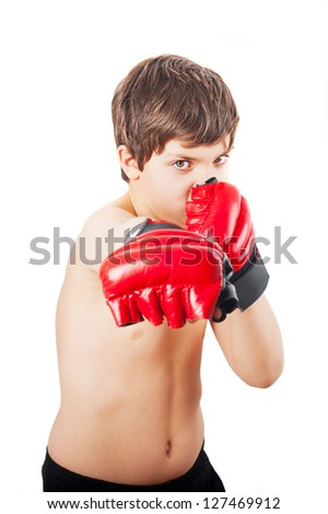 European school-age boy shirtless with boxing gloves - stock photo