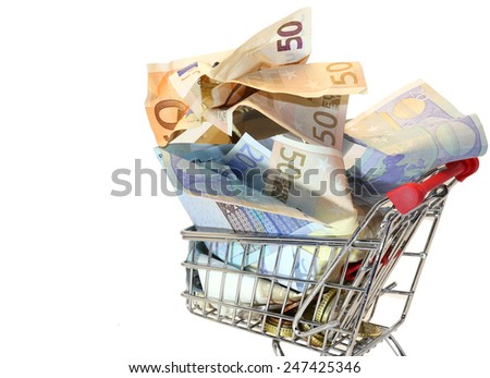 european shopping cart full of crumpled euro money - stock photo