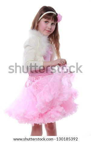 European small girl in a pink dress with a hairstyle