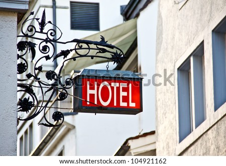 European style hotel's signboard in old town - stock photo