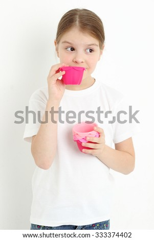 European teen girl holding molds for baking cookies