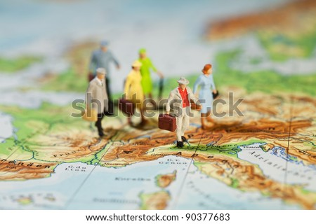 European Tourism And Travel, a group of miniature model tourists with luggage on a map of Europe, shallow DOF - stock photo