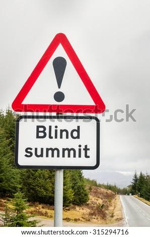 European Triangular Warning Sign on a Mountain Road - stock photo