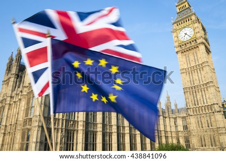 European Union and British Union Jack flag flying in motion blur in front of Big Ben and the Houses of Parliament at Westminster Palace, London, in preparation for the Brexit EU referendum - stock photo