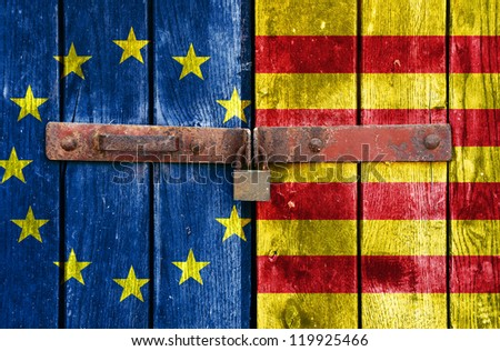 European Union and Catalonia flag on the background of old locked doors - stock photo