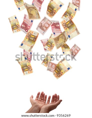 European Union Currency falling from above into the hands of somebody. Isolated on white background. - stock photo