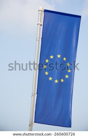 European Union flag on blue sky background - stock photo