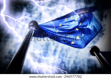 European Union flag on dark thunderstorm sky background  - stock photo
