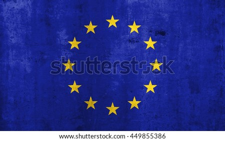 European Union flag with grunge wall texture background.