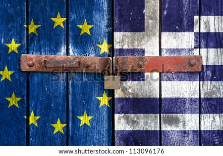 European Union flag with the Greek flag on the background of old locked doors - stock photo