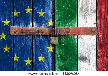 European Union flag with the Italian flag on the background of old locked doors - stock photo