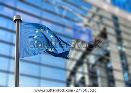 European Union flags in front of the blurred European Parliament in Brussels, Belgium