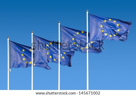 European Union Flags over sky background - stock photo