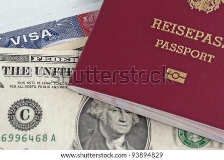 European Union passport, dollars and US visa - stock photo
