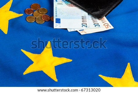 Euros and a Wallet on the EU Flag - stock photo
