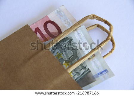Euros in a Brown Paper Bag - stock photo