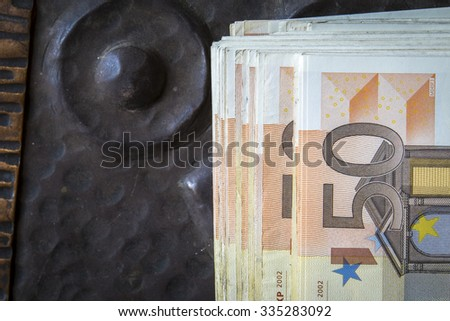 Euros in front of an old arcade - stock photo