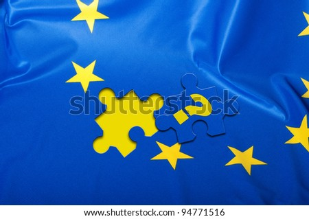 Euroscepticism - Detail of Silky Flag of Blue European Union EU Flag Drapery With Puzzle Piece With Question Mark - stock photo