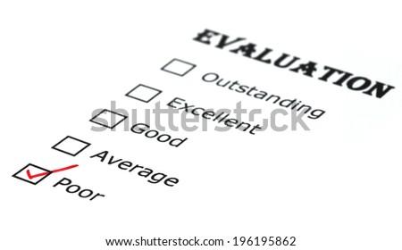 Evaluation check box on white paper - stock photo
