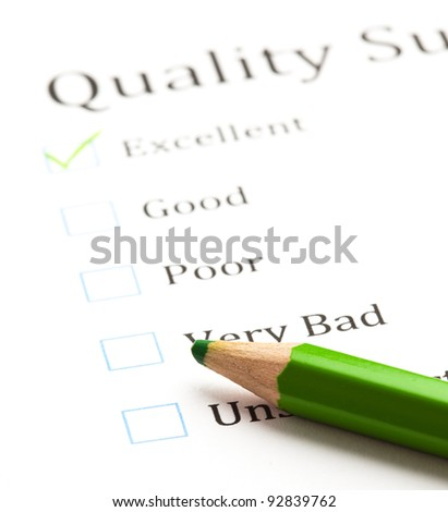 evaluation check boxes and green pen - stock photo