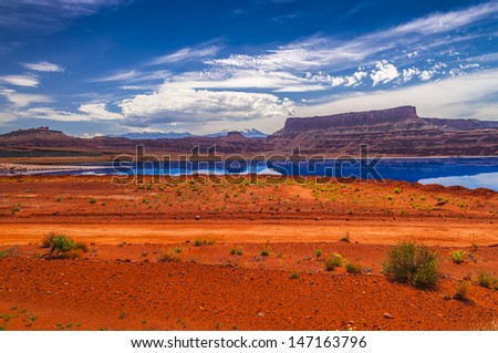 Evaporation Pools with La Sale Mountains in the Back against beautiful blue sky - stock photo