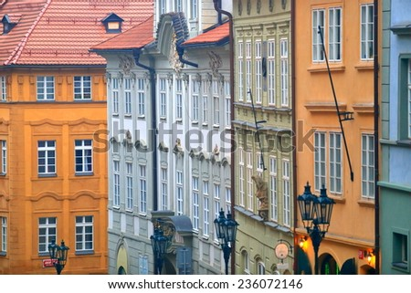 Evening approaching with lamps illuminating beautiful facades on the streets of Prague Old Town, Czech Republic - stock photo