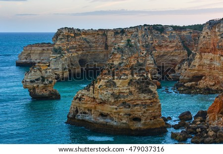 Evening Atlantic rocky coastline  top view from (Lagoa, Algarve, Portugal).