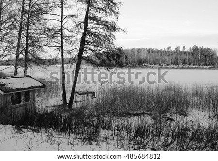 Evening by a frozen lake, in black and white.