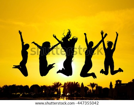 Evening Celebration Jumping over Sunset