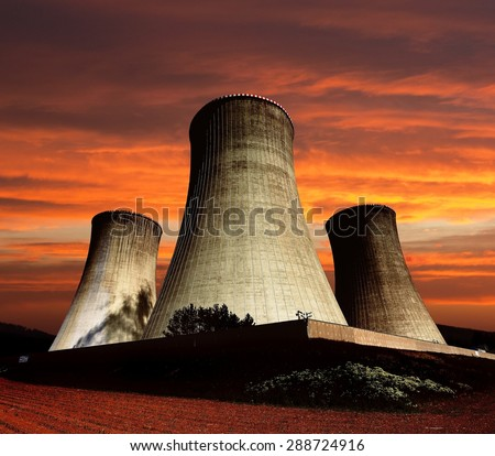 Evening colored view of cooling tower - Nuclear power plant Dukovany - stock photo