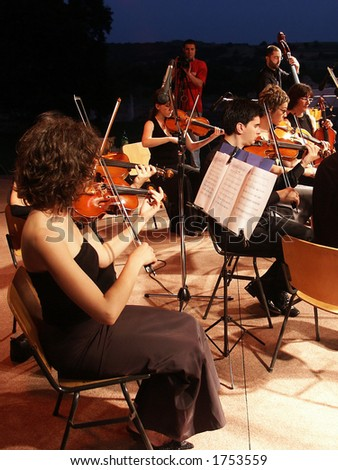 Evening concert of string band - stock photo