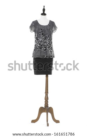 Evening female dress on a dummy isolated on a white background  - stock photo