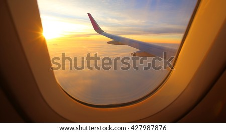 Evening flight on twilight sky, amazing view from the window plane. - stock photo