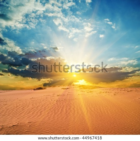 evening in a red sand desert - stock photo