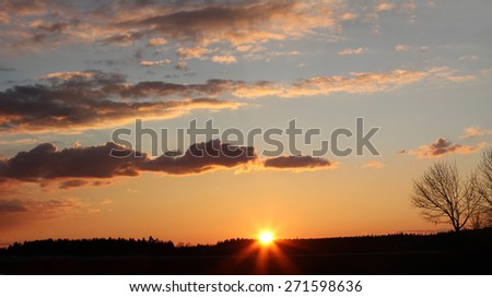 evening in the fields with beautiful sunset sky - stock photo