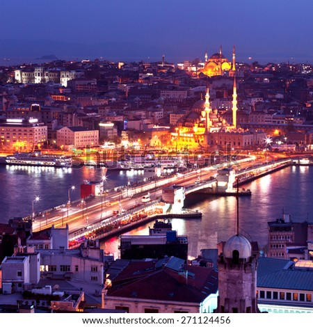 Evening Istanbul. Galata Bridge. Panorama of the evening city from the tower. - stock photo