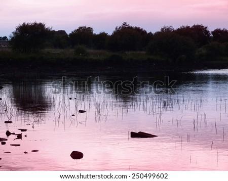Evening lake in Scotland  - stock photo