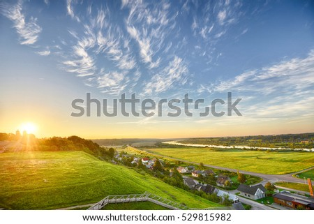evening landscape. sky over village  and fields