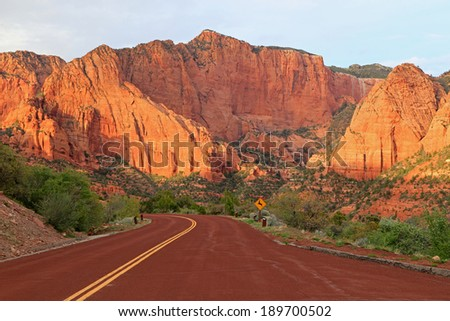 Evening light above a mountain road in Zion National Park, Utah, USA. - stock photo