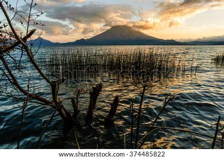 Evening light on Toliman volcano on Lake Atitlan, Guatemala. Photo taken from Santa Cruz la Laguna. - stock photo