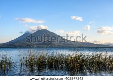 Evening light on two volcanoes, Atitlan & Toliman, at Lake Atitlan, Guatemala. - stock photo