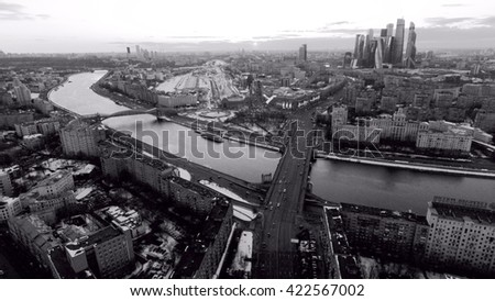 evening moscow city aerial view. Black and White view on a river and a road, going to the skyscrapers. - stock photo