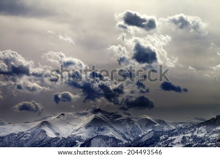 Evening mountains and cloudy sky. Caucasus Mountains. Georgia, view from ski resort Gudauri.
