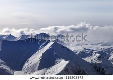 Evening mountains in haze. Caucasus Mountains, Georgia, view from ski resort Gudauri. - stock photo