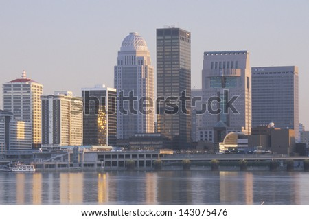 Evening on Ohio River and Louisville skyline, KY - stock photo